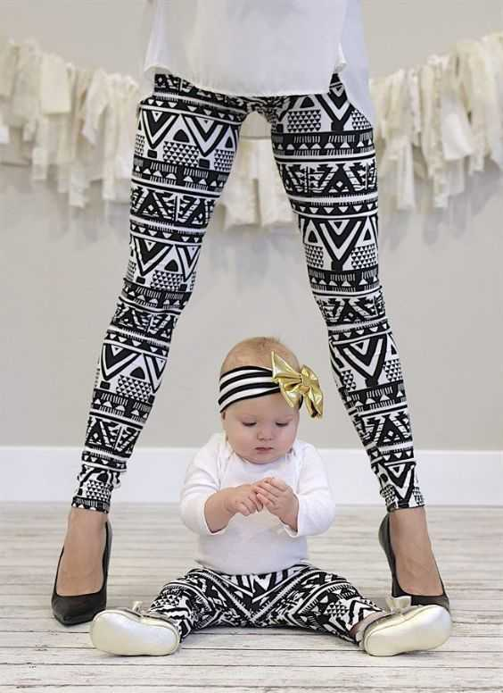 Mommy And Me Outfit: white shirt, black and white tribal leggins, black heels, white sneakers, black and white headband #outfit #baby #fashion #cute