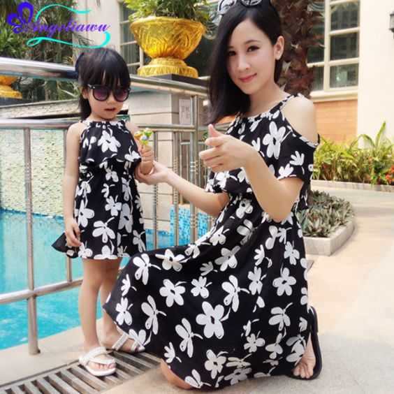 Mommy And Me Outfit: black floral halter dress, white sandals, black sandals, sunglasses #outfit #floral #pool #mommy