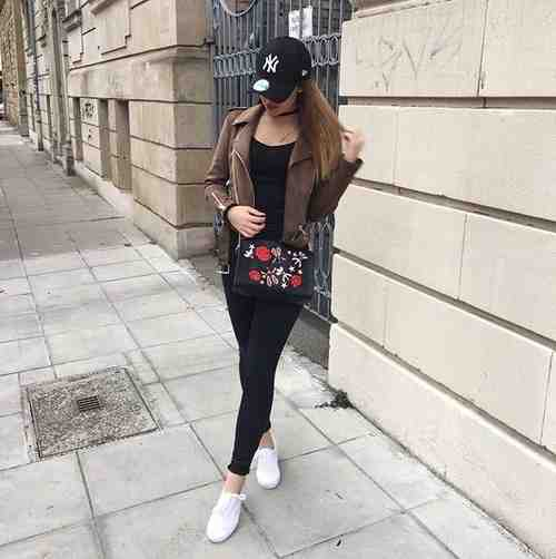 Outfits for school: brown faux leather jacket, black top, black skinny jeans, white sneakers, black floral crossbody bag, black cap #outfitideas #teen #school #fashion