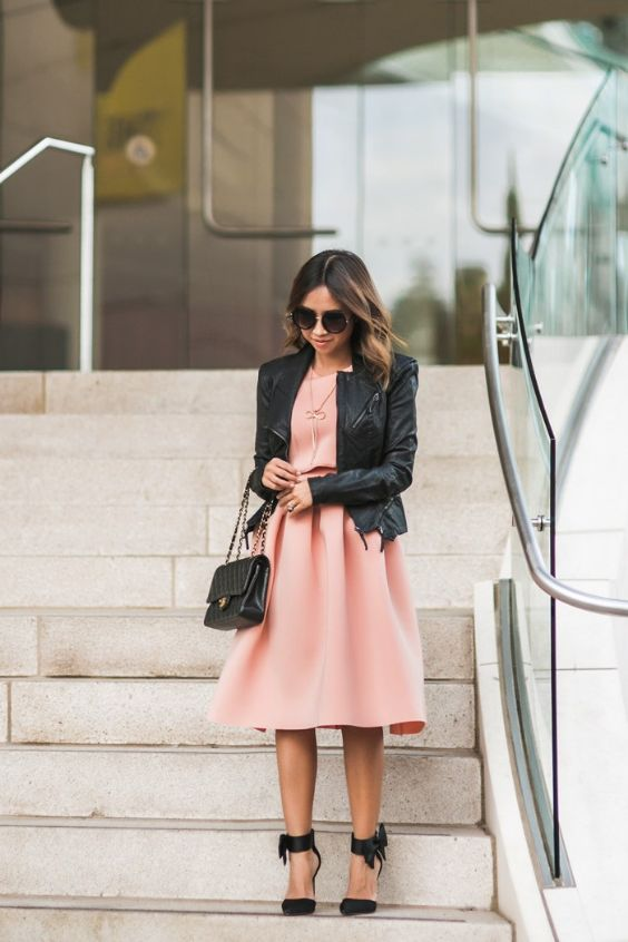 Pink Outfits: black faux leather jacket, peach pink dress, black ankle strap heels, black handbag, necklace, sunglasses #outfitideas #brunette #trendy #pink