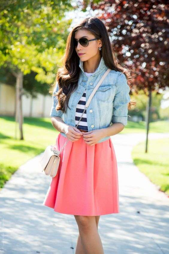 Pink Outfit: denim jacket, black and white striped top, coral pink circle skirt, white crossbody bag, earrings, sunglasses #outfitideas #pink #park #trendy
