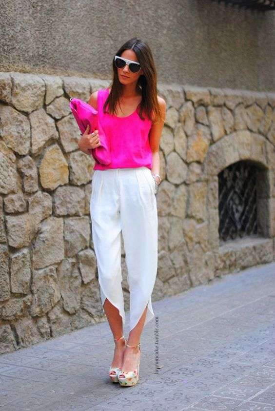 Pink Outfits: hot pink sleeveless top, hot pink purse, white asymmetrical capri pants, beige floral t-strap heels, sunglasses, hoop earrings #outfit #fuchsia #brunette #woman