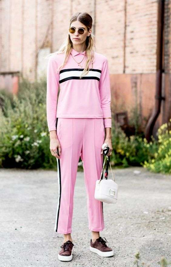 Pink Outfit: pink, black and white sweatshirt and sweatpants set, brown and white sneakers, necklace, sunglasses, white bag #outfit #pink #sports #blonde
