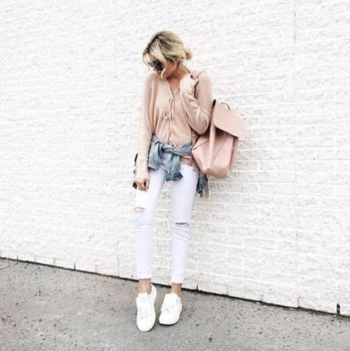 Pink Outfits: blush pink lace-up sweater, denim jacket, white ripped jeans, white sneakers, blush pink bag, sunglasses #outfit #pink #blonde #trendy