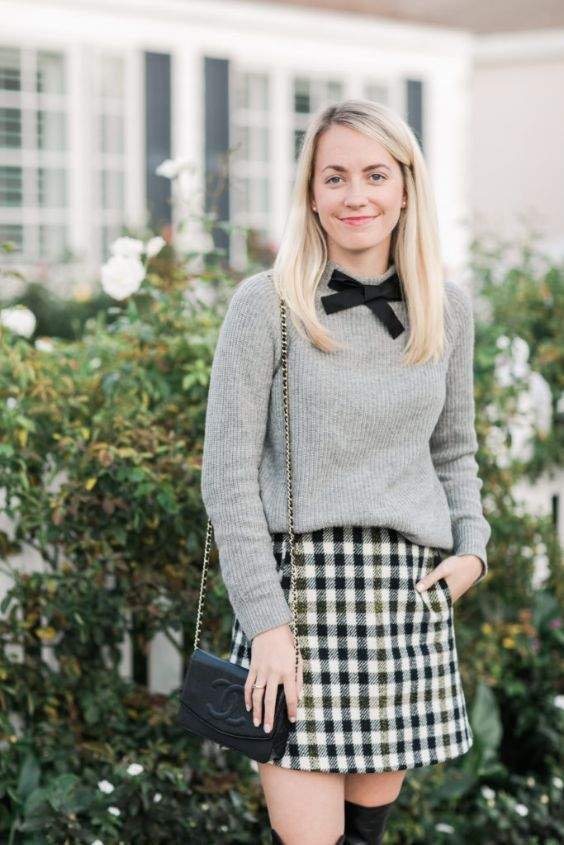 Preppy Outfits: gray sweater, black bow, black and white checked skirt, black crossbody bag, earrings #outfitoftheday #blonde #smile #girl