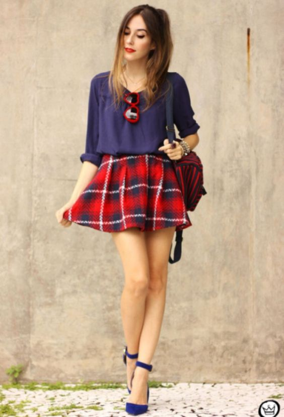 Preppy Outfit: navy blue half sleeve blouse, red and navy blue plaid skirt, navy blue t-strap heels, red and navy blue bag, red sunglasses #outfitoftheday #hairstyle #makeup #red