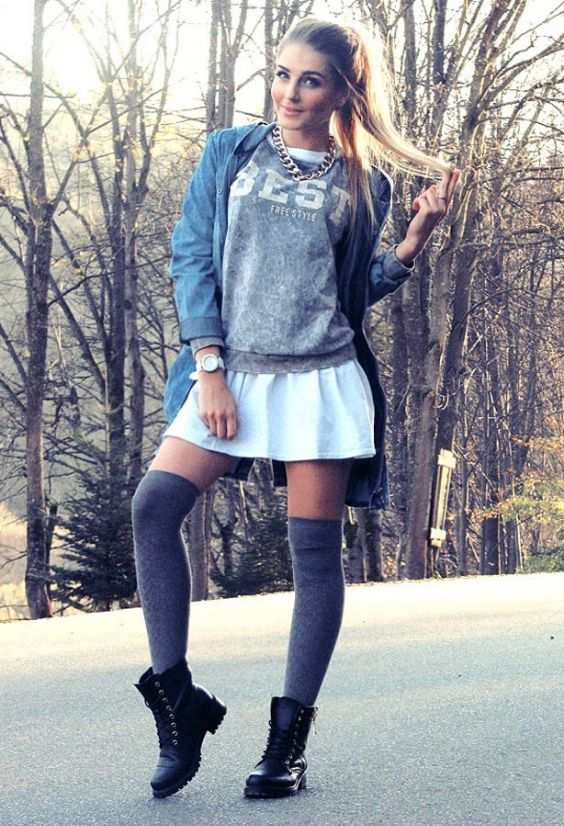Preppy Outfit: gray sweater, white mini dress, gray knee high socks, black army boots, denim jacket, chain necklace, watch #outfitoftheday #blonde #trendy #college