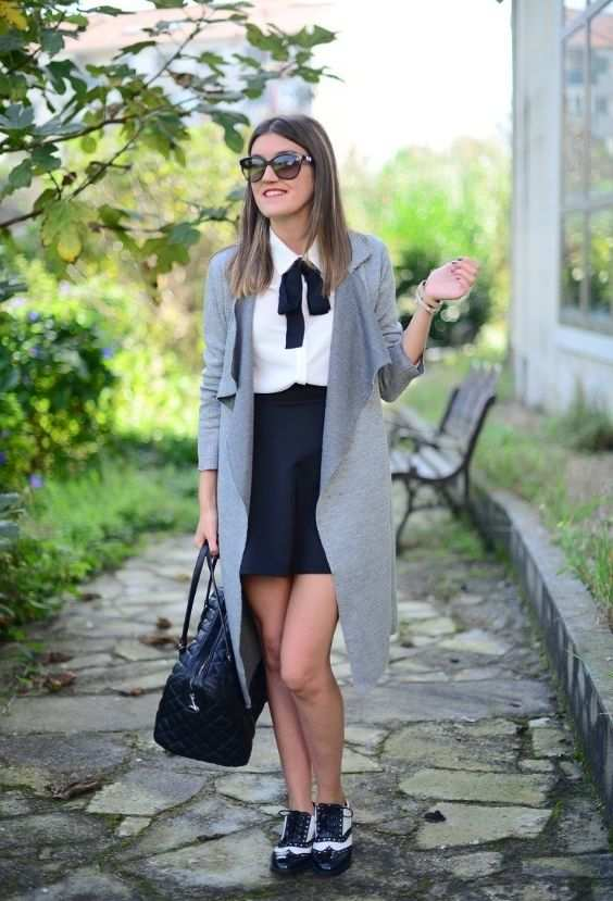 Preppy Outfits: gray coat, white bow front blouse, black skirt, black handbag, black and white oxford shoes, sunglasses, bracelets #outfitoftheday #girl #college #fashion