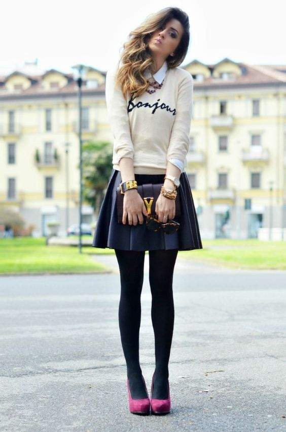 Preppy Outfit: beige sweater, white shirt, black pleat skirt, black tights, pink heels, black purse, watch, bracelets #outfit #preppy #girl #cute