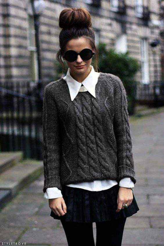 Preppy Outfit: dark gray sweater, white shirt, black pleat skirt, black tights, sunglasses #outfit #hairstyle #brunette #chic