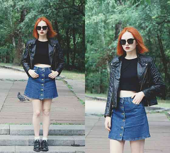 Punk Outfits: black faux leather jacket, black crop top, denim skirt, black martens shoes, sunglasses #outfitideas #redhair #girl #punk