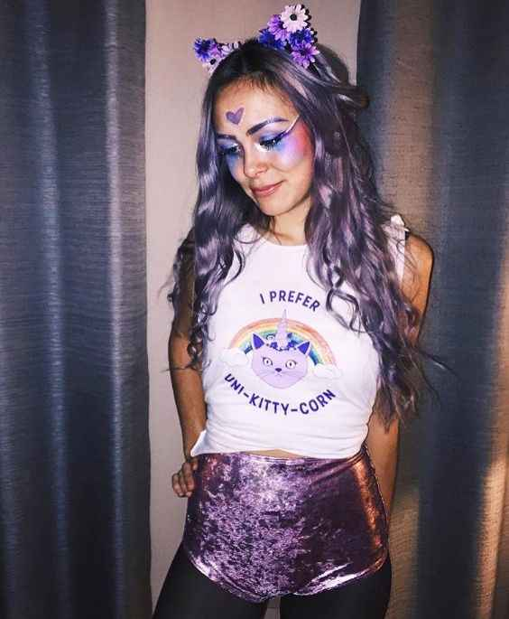 Rave Outfits: white sleeveless crop top, metallic purple bikini bottom, black tights, floral cat ears headband #outfitideas #costume #cat #makeup