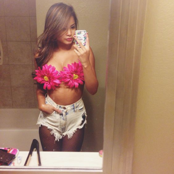 Rave Outfits: pink floral bralette, denim ripped shorts #outfit #coachellaoutfits #concertoutfits #rave