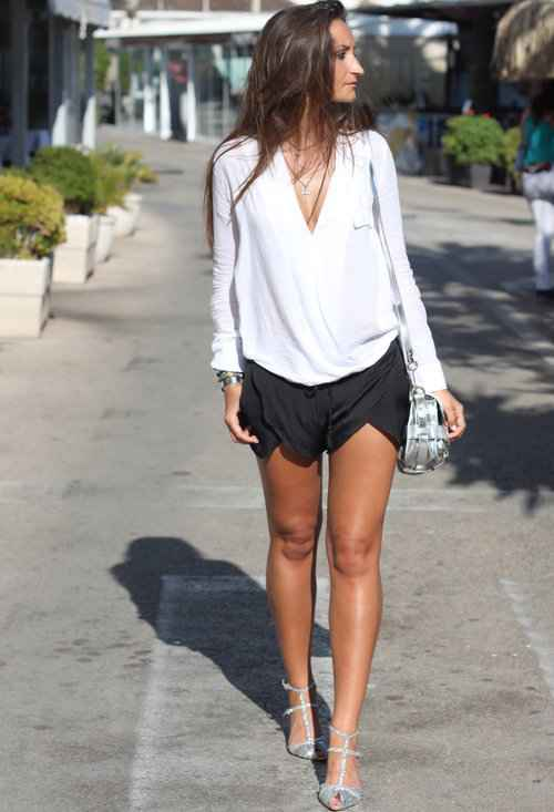Sexy Outfit: white long sleeve v-neck blouse, black shorts, silver heels, silver crossbody mini bag #outfit #sexyoutfit #brunette #fashion