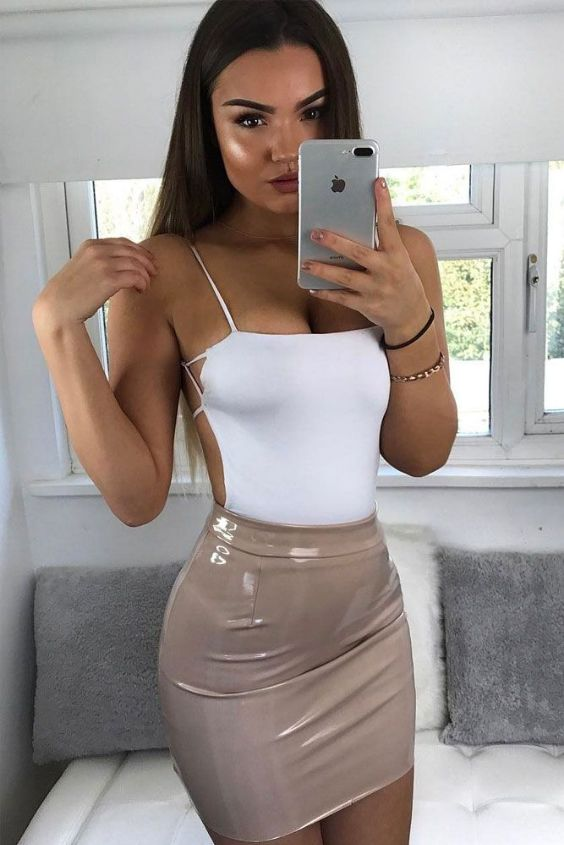 Sexy Outfit: white spaghetti strap backless top, beige faux leather mini skirt, bracelet #outfitoftheday #brunette #makeup #longhair