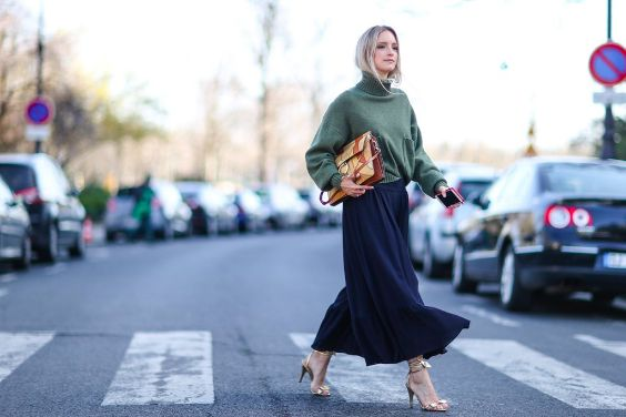 Spring Outfit: army green turtleneck puff sleeve sweater, black maxi skirt, golden high heel sandals, orange handbag #outfit #elegant #women #urban