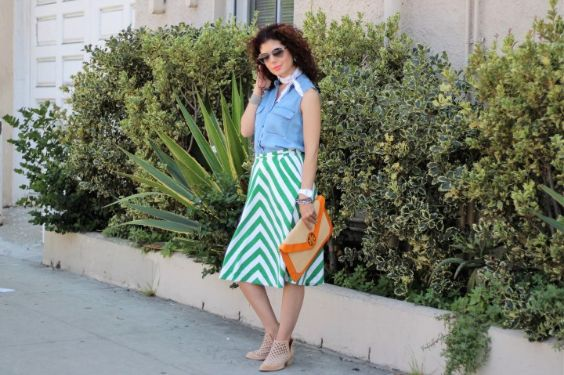Spring Outfit: denim sleeveless shirt, green and white skirt, nude heels, white kerchief, orange and beige purse, bracelets, sunglasses #outfitoftheday #green #women #fashion