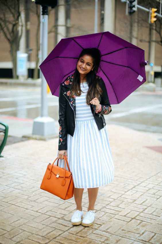 Spring Outfits: sky blue and white striped dress, white sneakers, orange handbag, black floral faux leather jacket #outfitideas #dress #floral #cute