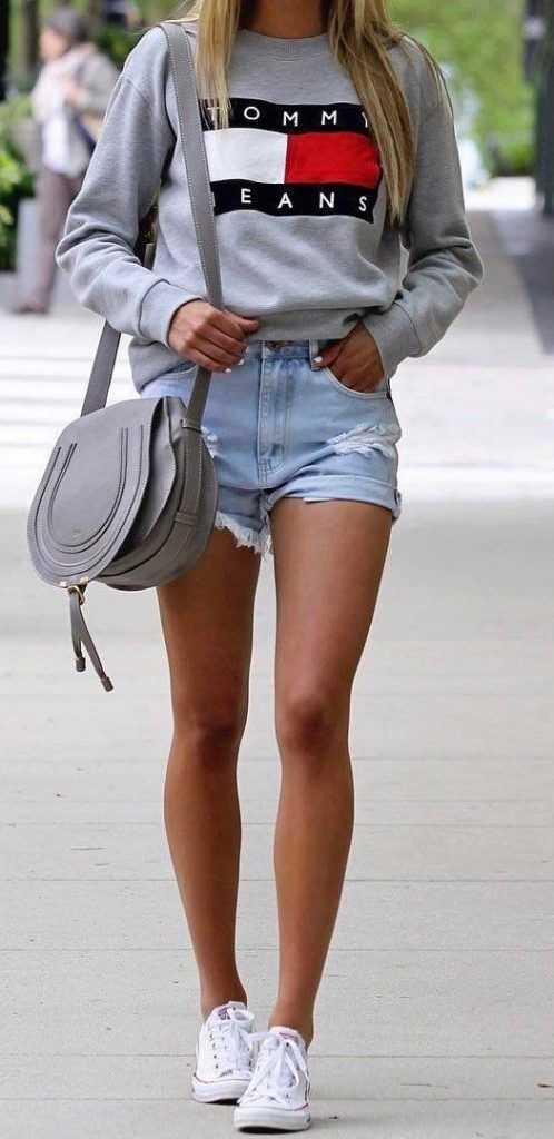 Summer Outfits: gray hoodie, ripped denim shorts, gray crossbody bag, white sneakers #outfitoftheday #cute #sweatshirt #girl