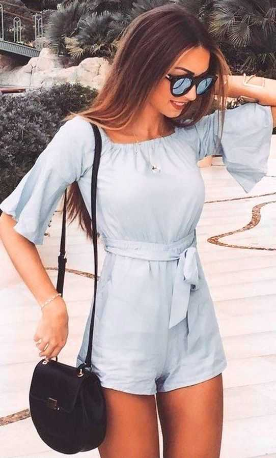 Summer Outfit: light blue bell sleeve romper, necklace, black crossbody bag, sunglasses #outfit #trendy #women #blue