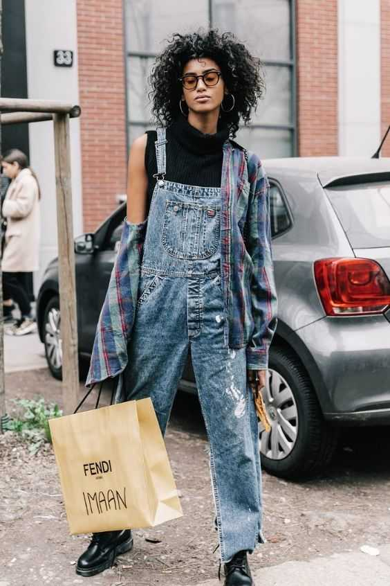 Tomboy Outfit: black turtleneck sleeveless top, denim overall, blue lumberjack shirt, black martens shoes, hoop earrings #outfitideas #overall #glasses #fashion