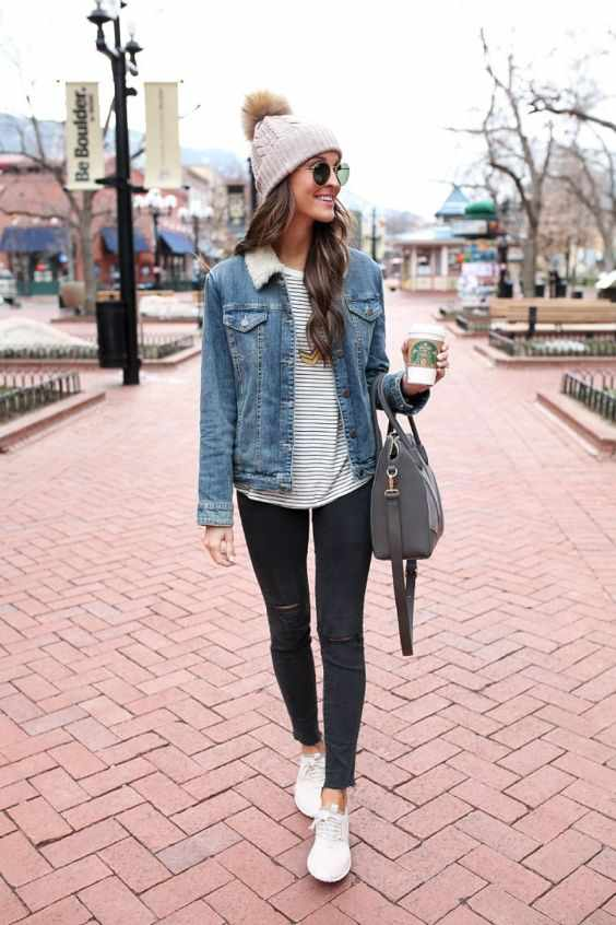 Winter Outfit: denim jacket, black and white striped sweater, black ripped jeans, dark gray bag, beige winter hat, sunglasses #outfitideas #winteroutfit #longhair #fashion