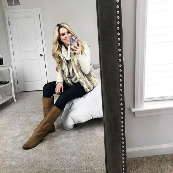 Winter Outfit: beige turtleneck sweater, beige faux fur sleeveless jacket, black skinny pants, brown boots #outfit #women #trendy #blonde