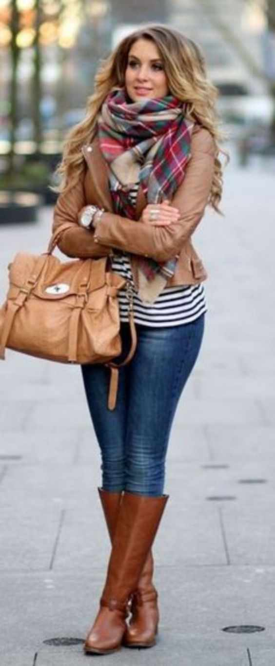 Winter Outfit: brown faux leather jacket, black and white striped top, skinny jeans, camel boots, camel handbag, red plaid scarf #outfit #blonde #longhair #cold