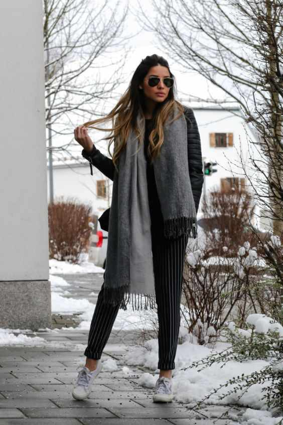 Winter Outfit: black jacket, gray scarf, black and white striped pants, white sneakers, sunglasses #outfitoftheday #winteroutfit #hairstyle #fashion