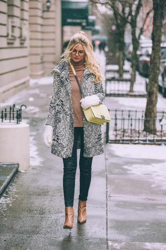 Winter Outfits: black and white coat, brown sweater, skinny jeans, camel booties, yellow crossbody bag, white gloves #outfitideas #blonde #glasses #snow