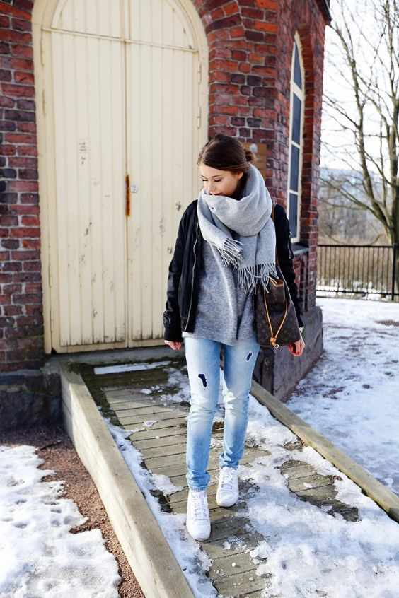 Winter Outfits: gray scarf, gray shirt, black jacket, ripped jeans, white sneakers, brown bag #outfit #brunette #snow #fashion
