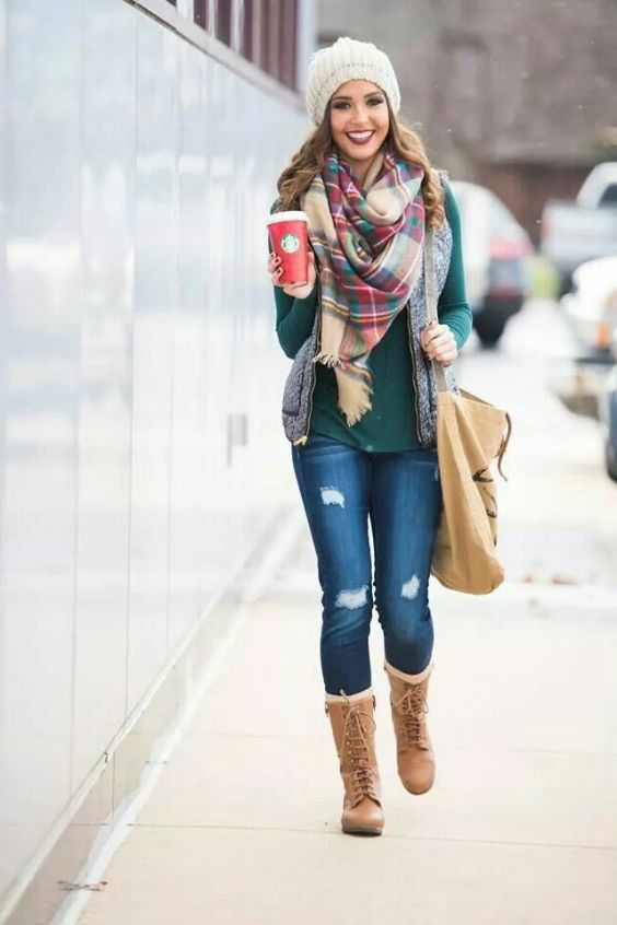 Winter Outfit: green sweater, gray sleeveless jacket, ripped jeans, camel lace-up boots, light brown crossbody bag, white winter hat, plaid scarf #outfitoftheday #cold #women #fashion