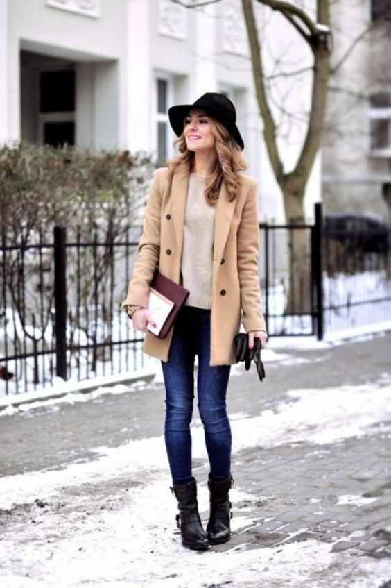 Winter Outfit: light brown coat, beige sweater, skinny jeans, black boots, black wide brim hat, gloves #outfit #winter #snow #dailylook