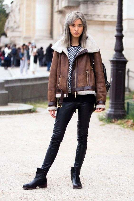 Winter Outfits: brown faux leather jacket, black and white top, black faux leather skinny pants, black booties, black bag #outfit #hairstyle #cold #fashion