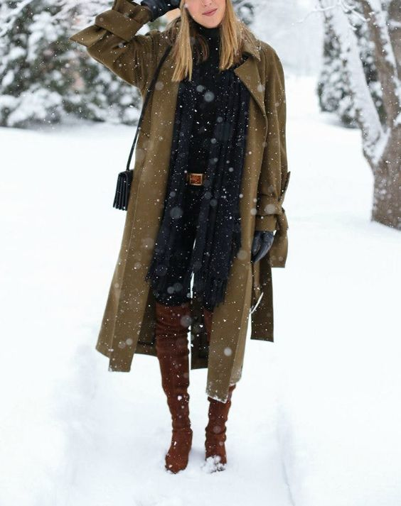 Winter Outfit: army green longline coat, black turtleneck top, black skinny pants, camel belt, black scarf, camel knee high boots, black crossbody bag, gloves #outfitoftheday #blonde #snow #trendy