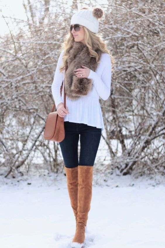 Winter Outfit: white peplum long sleeve shirt, skinny jeans, camel knee high boots, brown faux fur scarve, camel crossbody bag, white winter hat, sunglasses #outfit #white #fashion #cute