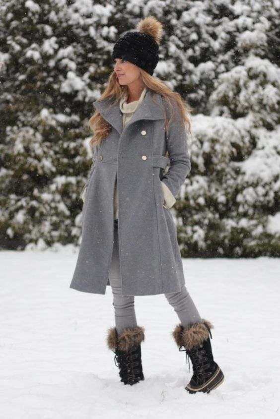 Winter Outfits: gray longline coat, beige turtleneck sweater, gray skinny jeans, black and brown mid calf boots, black winter hat #outfitideas #snow #longhair #blonde