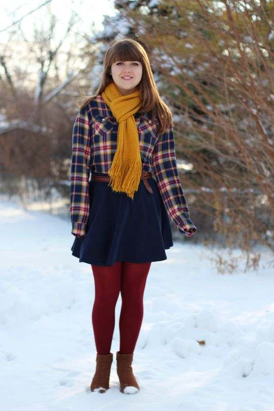 Winter Outfit: blue lumberjack shirt, yellow scarve, navy blue circle skirt, camel belt, red tights, camel booties #outfitideas #fashion #girl #trendy