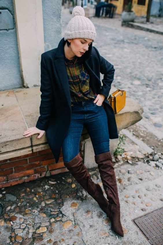 Winter Outfit: black coat, green lumberjack shirt, skinny jeans, brown knee high boots, light gray winter hat #outfit #cold #trendy #casual