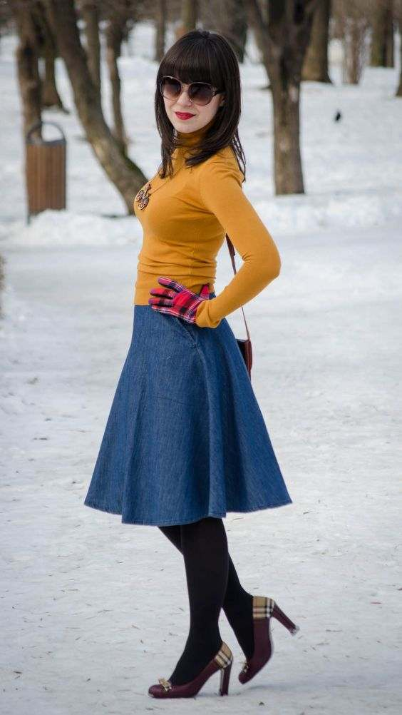 Winter Outfit: yellow turtleneck sweater, denim circle skirt, black tights, brown heels, red gloves, necklace, sunglasses #outfitideas #snow #fashion #brunette
