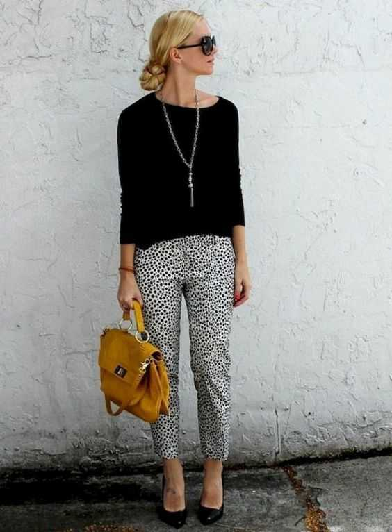 Work Outfits: black sweater, black and white point print capri, yellow handbag, long necklace, black heels, sunglasses #outfit #black #professional #women